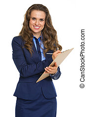 Smiling business woman writing in clipboard