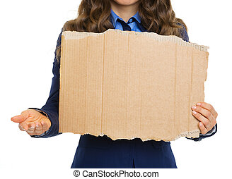 Closeup on business woman with hand outstretched for alms showing blank cardboard