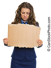 Upset business woman showing blank cardboard