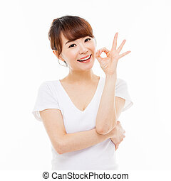 Cute woman with okay hand gesture isolated on white...