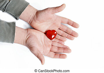 Give heart - small heart symbol in man hands over white