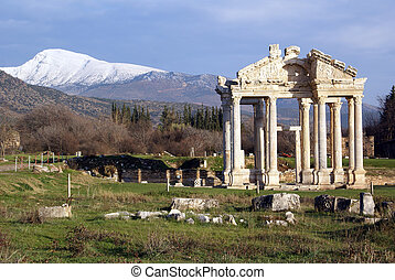 Ruins - Old ruins and mountain with snow in Aphrodisias,...