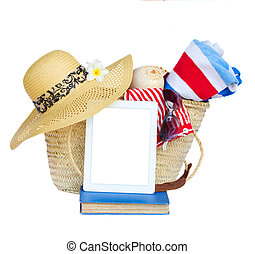 sunbathing accessories in basket with tablet