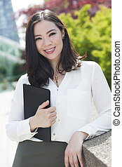 Smiling Young Asian Woman or Businesswoman