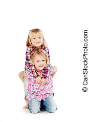 Smiling Sisters Against White Background - Portrait of happy...