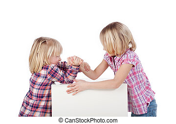 Who is the stronger - two cute little blonde sisters test it...
