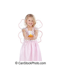 Girl In Fairy Costume Holding Cupcake Against White...