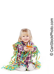 Girl Wrapped With Ribbons Offering Cupcake - Portrait of...