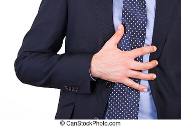 Businessman suffering from heartburn