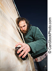 Serious Bearded Man Spray Painting