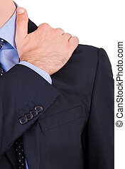 Businessman suffering from shoulder pain.