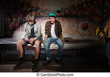Two Bored Youth - Two bored homeless white teenagers sitting...