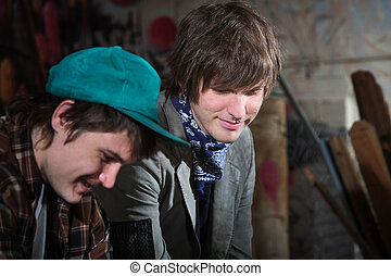 Unemployed Youth - Smiling teen friends sitting in urban...