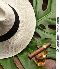 the spirit of Cuba - cigar on a glass of rum, panama and...