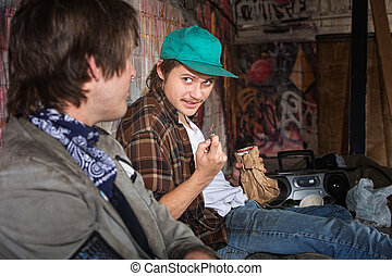 Homeless Teens Talking - Two homeless teenagers with brown...