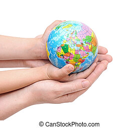 Globe in baby's hands, isolated on a white background