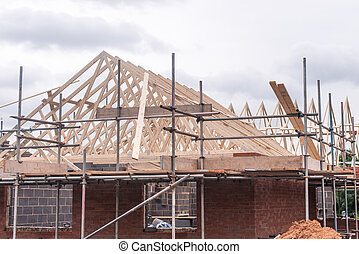 roof under construction - a roof under construction with...
