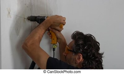 man with drill - Construction worker with hand drill