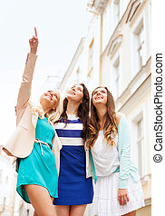 beautiful girls looking at something in the city - holidays...