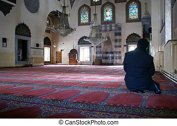 Man inside mosque in Afyon, Turkey