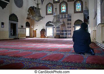 Man inside mosque in Afyon, Turkey