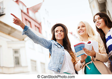 beautiful girls looking for direction in the city - holidays...