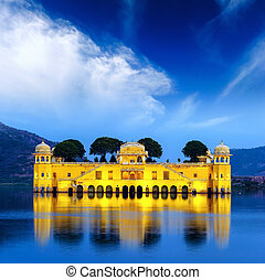 Indian water palace on Jal Mahal lake at night time in...
