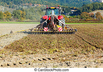 Ploughing heavy tractor during cultivation agriculture works...