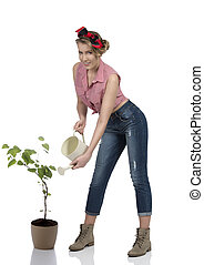 portrait of sexy female gardener - pretty blonde gardener...