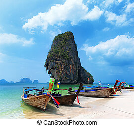 Travel boat on Thailand island beach. Tropical coast Asia...