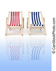 Deckchairs - Red and blue deckchair reflecting in water