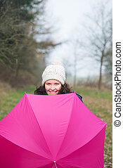Young Woman With Pink Umbrella In Park - Portrait of happy...
