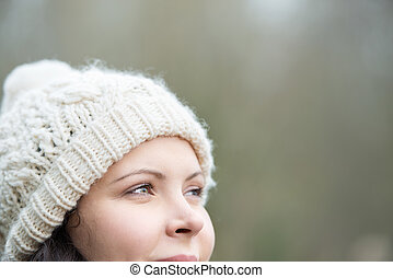 Smiling woman wearing a cap in winter - Smiling woman...