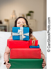 Woman carrying a huge pile of gifts - Woman carrying a huge...