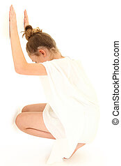 Tween Girl Hiding Against White Wall - Tween girl in white...