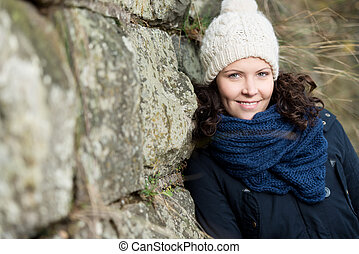 Woman dressed for cold weather with wool hat and scarf