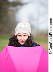 Beautiful woman in winter fashion wearing a woolly knitted...