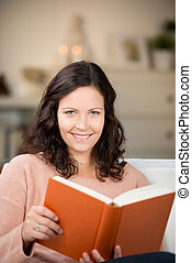 Woman Holding Book At Home