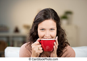 Woman enjoying a large cup of tea - Woman enjoying a large...