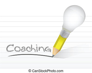 Coaching handwritten with lightbulb pencil over a notepad