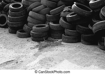 Waste tires. Old used car tires stack.