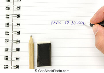 Writing back to school - Hand of a student writing Back to...