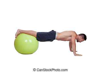 Strong man practicing pushups with a big ball isolated on a...