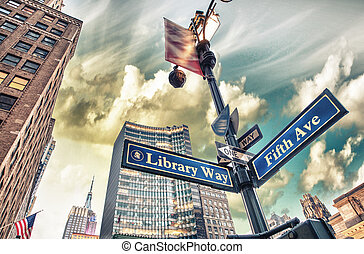Library Way and 5th Avenue street sign in New York City.