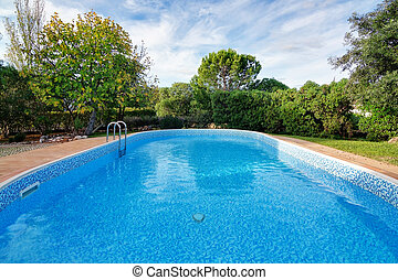 Luxury summer swimming pool. For relaxation and swimming. Summer.