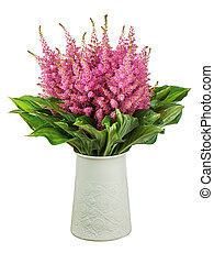 Colorful bouquet from astilbe and funkia flowers in vase...