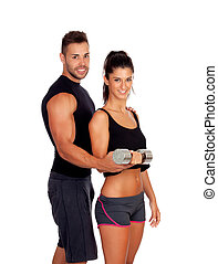 Attractive woman and a personal trainer with weight training