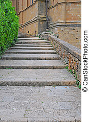 streetview in pienza, italy - streetview with stairs in the...