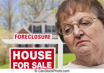 Depressed Senior Woman in Front of Foreclosure Real Estate...