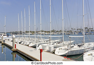 Yacht club sailboats - Identical luxury boats in a row....